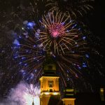 Fireworks cracking over the old town of Warsaw, Poland